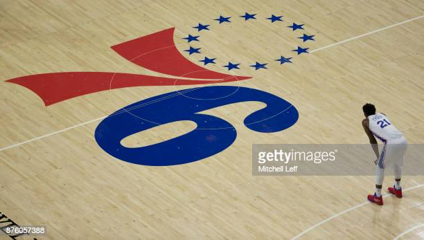 Joel Embiid of the Philadelphia 76ers looks on against the Golden State Warriors in the at the Wells Fargo Center on November 18 2017 in Philadelphia...