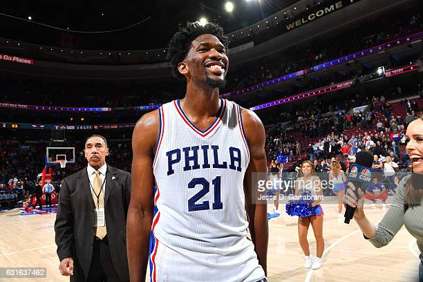 Joel Embiid of the Philadelphia 76ers looks on celebrating their victory after the game against the Charlotte Hornets on January 13 2017 at Wells...