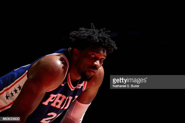 Joel Embiid of the Philadelphia 76ers looks on during the game against the Brooklyn Nets on October 11 2017 at Nassau Veterans Memorial Coliseum in...