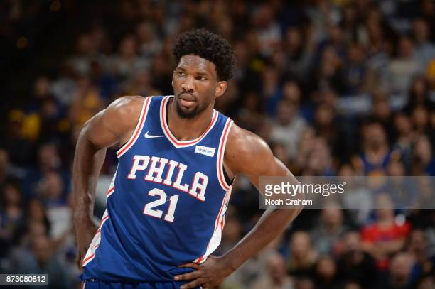 Joel Embiid of the Philadelphia 76ers looks on during the game against the Golden State Warriors on November 11 2017 at ORACLE Arena in Oakland...