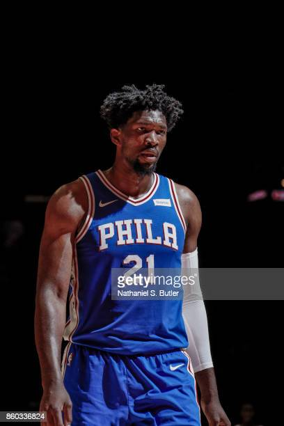Joel Embiid of the Philadelphia 76ers looks on during the preseason game against the Brooklyn Nets on October 11 2017 at Nassau Veterans Memorial...
