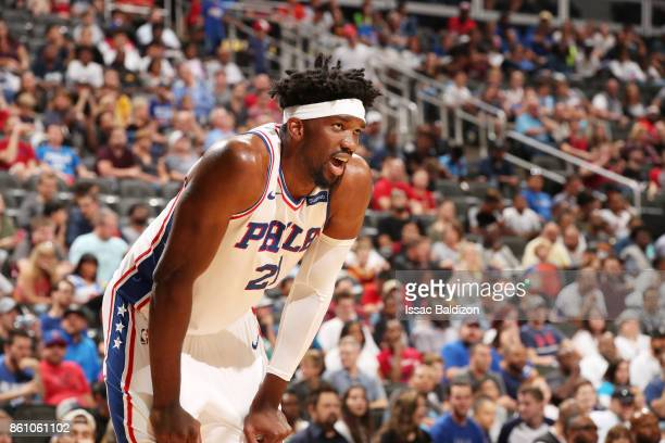 Joel Embiid of the Philadelphia 76ers looks on during the preseason game against the Miami Heat on October 13 2017 at Sprint Center in Kansas City...