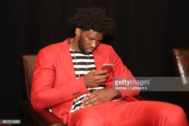 Joel Embiid of the Philadelphia 76ers looks on his phone during the 2017 NBA Draft Lottery at the New York Hilton in New York New York NOTE TO USER...