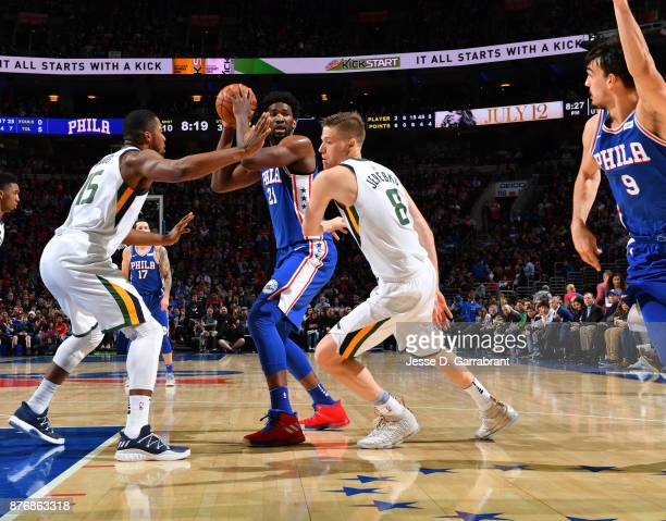 Joel Embiid of the Philadelphia 76ers looks to pass the ball inside against the Utah Jazz at Wells Fargo Center on November 20 2017 in Philadelphia...
