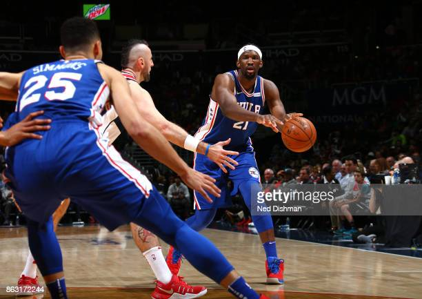 Joel Embiid of the Philadelphia 76ers makes a pass against the Washington Wizards on October 18 2017 at Capital One Arena in Washington DC NOTE TO...