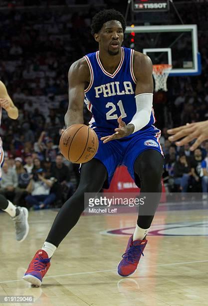 Joel Embiid of the Philadelphia 76ers passes the ball against the Oklahoma City Thunder at Wells Fargo Center on October 26 2016 in Philadelphia...