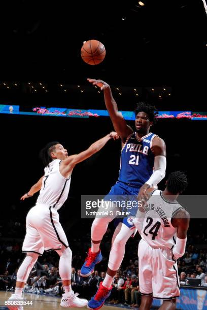 Joel Embiid of the Philadelphia 76ers passes the ball against the Brooklyn Nets on October 11 2017 at Nassau Veterans Memorial Coliseum in Uniondale...