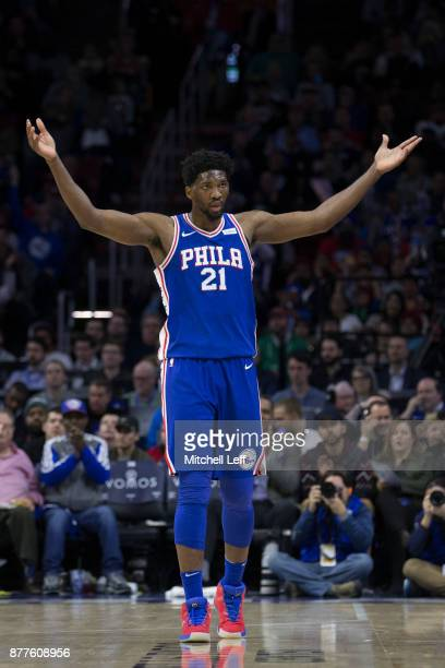 Joel Embiid of the Philadelphia 76ers reacts after getting fouled and making a basket in the first quarter against the Portland Trail Blazers at the...