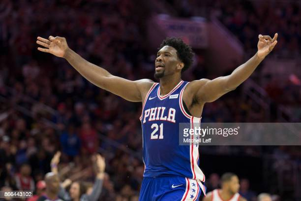 Joel Embiid of the Philadelphia 76ers reacts after making a three point basket in the fourth quarter against the Houston Rockets at the Wells Fargo...