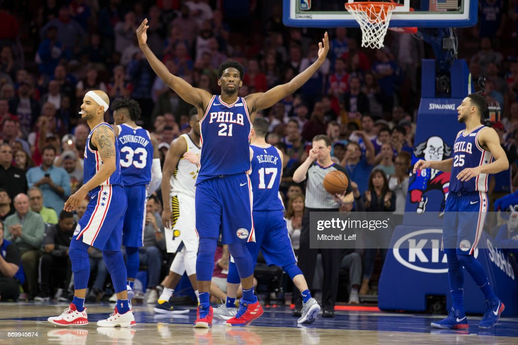 Joel Embiid #21 of the Philadelphia 76ers reacts along with Jerryd Bayless #0, Robert Covington #33, JJ Redick #17, and Ben Simmons #25 after a made foul shot in the fourth quarter against the Indiana Pacers at the Wells Fargo Center on November 3, 2017 in Philadelphia, Pennsylvania. The 76ers defeated the Pacers 121-110.