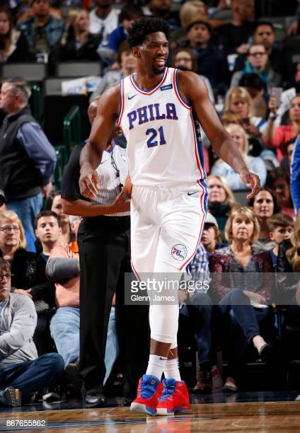 Joel Embiid of the Philadelphia 76ers reacts during the game against the Dallas Mavericks on October 28 2017 at the American Airlines Center in...