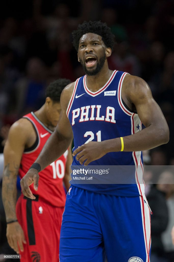 Joel Embiid #21 of the Philadelphia 76ers reacts in front of DeMar DeRozan #10 of the Toronto Raptors in the fourth quarter at the Wells Fargo Center on January 15, 2018 in Philadelphia, Pennsylvania. The 76ers defeated the Raptors 117-111.