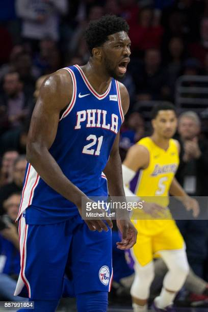 Joel Embiid of the Philadelphia 76ers reacts in front of Josh Hart of the Los Angeles Lakers in the second quarter at the Wells Fargo Center on...