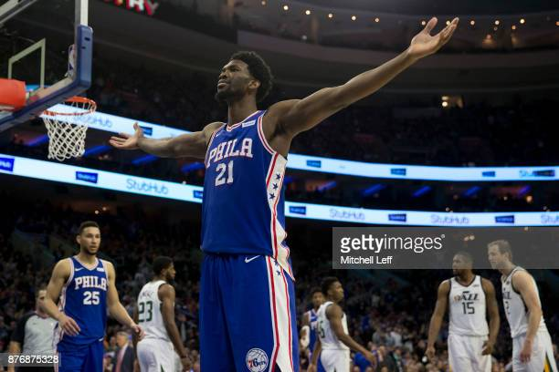 Joel Embiid of the Philadelphia 76ers reacts in front of Royce O'Neale Donovan Mitchell Derrick Favors and Joe Ingles of the Utah Jazz after making a...