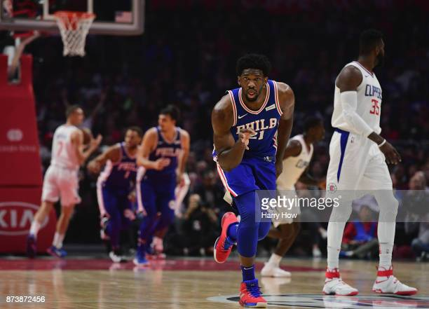 Joel Embiid of the Philadelphia 76ers reacts to his three pointer during the first half against the LA Clippers at Staples Center on November 13 2017...