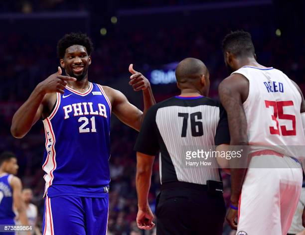 Joel Embiid of the Philadelphia 76ers reacts to Willie Reed of the LA Clippers during a 109105 76er win at Staples Center on November 13 2017 in Los...