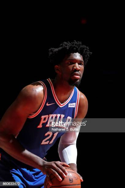 Joel Embiid of the Philadelphia 76ers shoots a free throw against the Brooklyn Nets during the preseason game on October 11 2017 at Nassau Veterans...