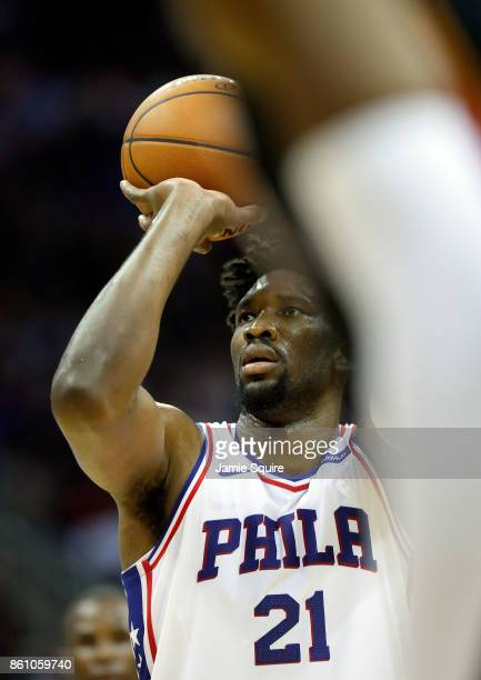 Joel Embiid of the Philadelphia 76ers shoots a free throw during the game against the Miami Heat at Sprint Center on October 13 2017 in Kansas City...