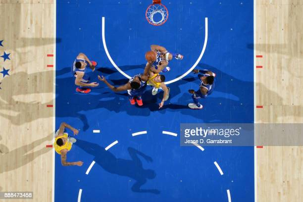 Joel Embiid of the Philadelphia 76ers shoots against Lonzo Ball of the Los Angeles Lakers on December 7 2017 at Wells Fargo Center in Philadelphia...