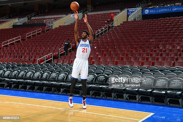 Joel Embiid of the Philadelphia 76ers shoots around prior to the game against the Miami Heat at Wells Fargo Center on April 15 2015 in Philadelphia...