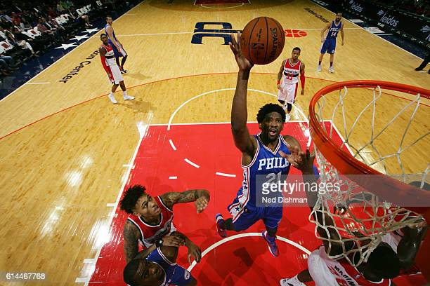 Joel Embiid of the Philadelphia 76ers shoots the ball against the Washington Wizards during a preseason game on October 13 2016 at Verizon Center in...