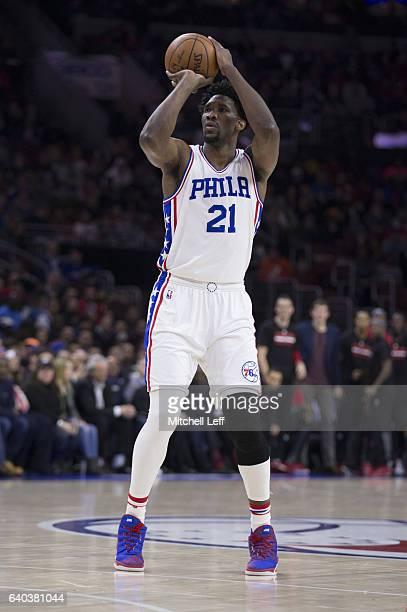 Joel Embiid of the Philadelphia 76ers shoots the ball against the Houston Rockets at the Wells Fargo Center on January 27 2017 in Philadelphia...