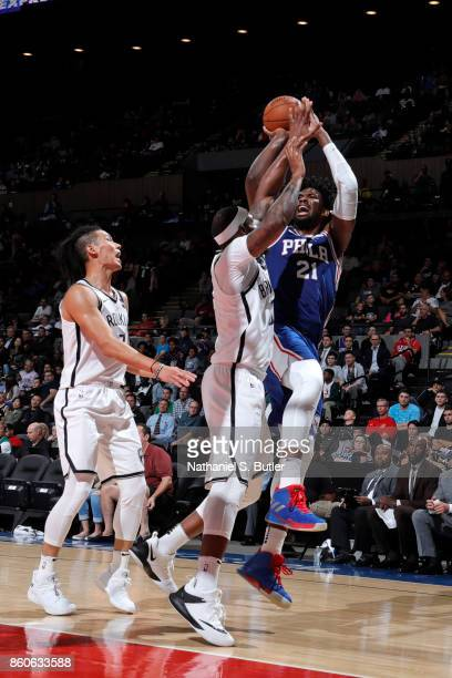 Joel Embiid of the Philadelphia 76ers shoots the ball against the Brooklyn Nets on October 11 2017 at Nassau Veterans Memorial Coliseum in Uniondale...