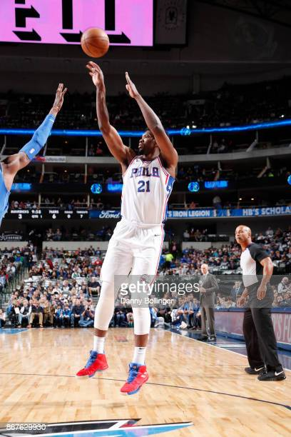 Joel Embiid of the Philadelphia 76ers shoots the ball against the Dallas Mavericks on October 28 2017 at the American Airlines Center in Dallas Texas...