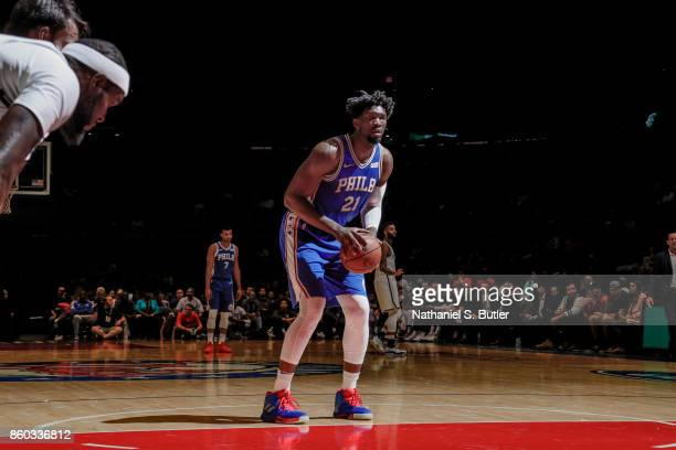 Joel Embiid of the Philadelphia 76ers shoots the ball during the preseason game against the Brooklyn Nets on October 11 2017 at Nassau Veterans...