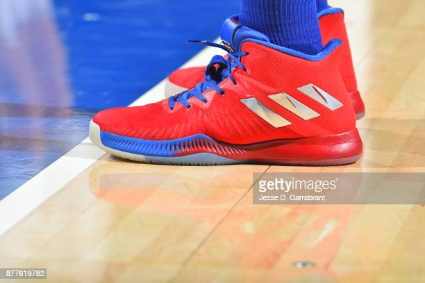 Joel Embiid of the Philadelphia 76ers showcases his sneakers against the Portland Trail Blazers at Wells Fargo Center on November 22 2017 in...