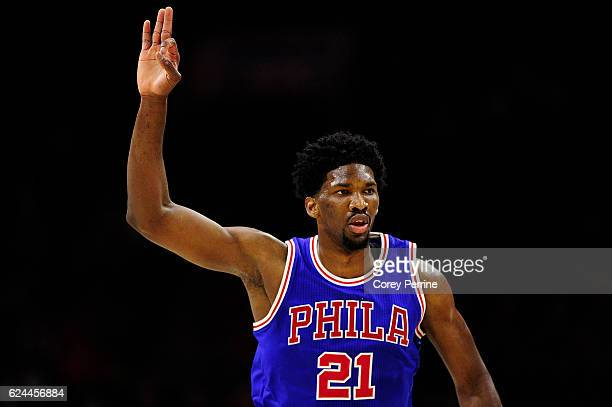 Joel Embiid of the Philadelphia 76ers signifies a threepointer during the first quarter against the Phoenix Suns at the Wells Fargo Center on...