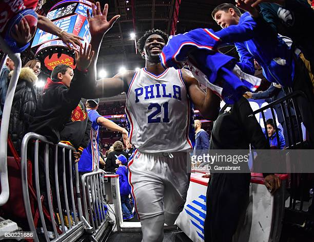 Joel Embiid of the Philadelphia 76ers smiles after the big win and dropping 33 points against the Brooklyn Nets at Wells Fargo Center on December 18...