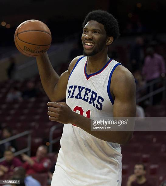 Joel Embiid of the Philadelphia 76ers smiles prior to the game aganist the Miami Heat on April 15 2015 at the Wells Fargo Center in Philadelphia...