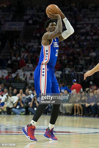 Joel Embiid of the Philadelphia 76ers takes a shot against the Oklahoma City Thunder at Wells Fargo Center on October 26 2016 in Philadelphia...