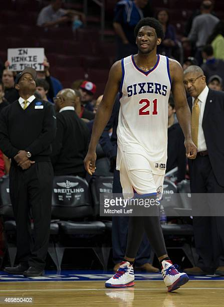Joel Embiid of the Philadelphia 76ers warms up prior to the game aganist the Miami Heat on April 15 2015 at the Wells Fargo Center in Philadelphia...