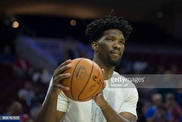 Joel Embiid of the Philadelphia 76ers warms up prior to the preseason game against the Memphis Grizzlies at the Wells Fargo Center on October 4 2017...