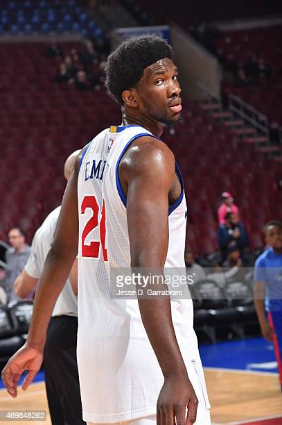 Joel Embiid of the Philadelphia 76ers warmsup prior to the game against the Miami Heat at Wells Fargo Center on April 15 2015 in Philadelphia...