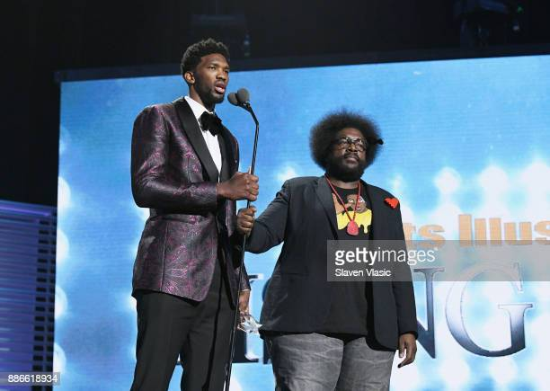 Joel Embiid receives the Rising Star of the Year Award from Questlove during SPORTS ILLUSTRATED 2017 Sportsperson of the Year Show on December 5 2017...