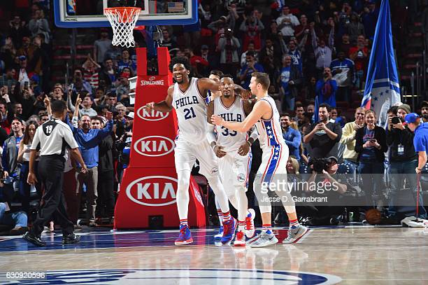 Joel Embiid Robert Covington and Nik Stauskas of the Philadelphia 76ers react after Covington hit the game winning shot against Minnesota...