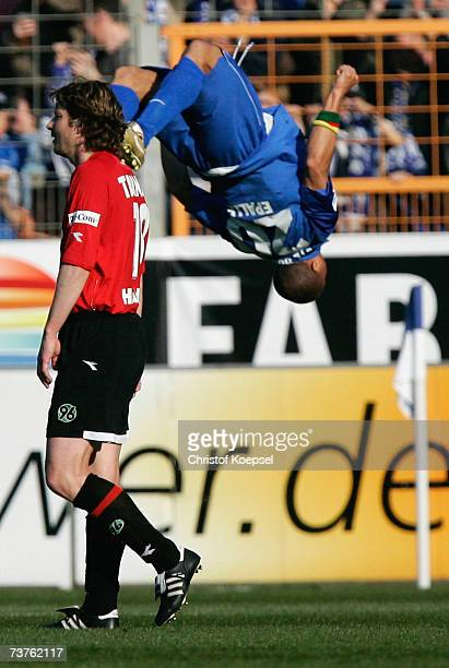 Joel Epalle of Bochum celebrates the second goal with a flicflac and Michael Tarnat of Hanover looks disappointed during the Bundesliga match bewteen...
