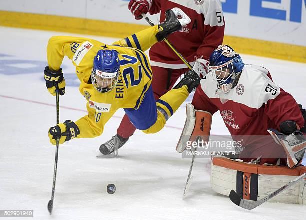 Joel Eriksson Ek of Sweden and goalkeeper Thomas Lillie of Denmark vie during the 2016 IIHF World Junior Ice Hockey Championship match between Sweden...