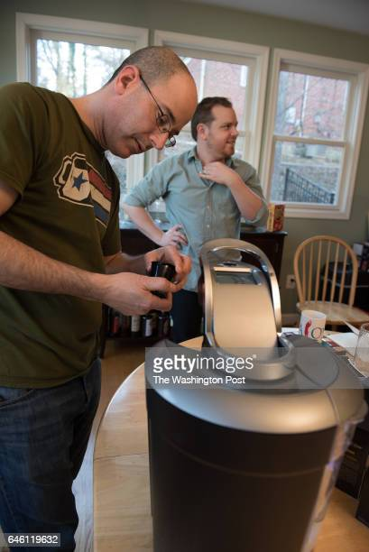 Joel Finkelstein of Qualia Coffee filling a Keurig selffill cup for story on attempting to improve Keurig k cup coffee Tito Pena of Wydown Coffeebar...