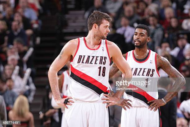 Joel Freeland and Dorell Wright of the Portland Trail Blazers stand on the court against the Los Angeles Clippers on December 26 2013 at the Moda...
