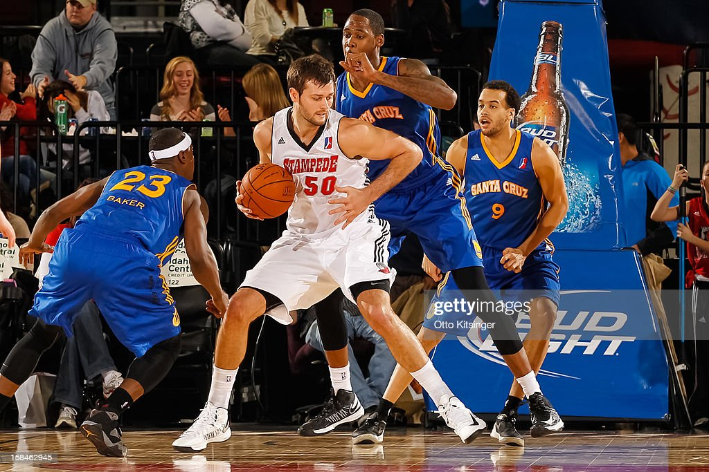 Joel Freeland #50 of the Idaho Stampede protects the ball from Mickell Gladness #32 of the Santa Cruz Warriors on December 15, 2012 at CenturyLink Arena in Boise, Idaho. Freeland was on assignment from the Portland Trail Blazers.