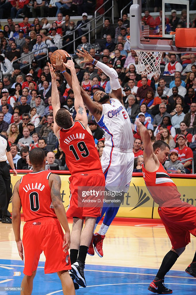 <a gi-track='captionPersonalityLinkClicked' href=/galleries/search?phrase=Joel+Freeland&family=editorial&specificpeople=757235 ng-click='$event.stopPropagation()'>Joel Freeland</a> #19 of the Portland Trail Blazers and <a gi-track='captionPersonalityLinkClicked' href=/galleries/search?phrase=DeAndre+Jordan&family=editorial&specificpeople=4665718 ng-click='$event.stopPropagation()'>DeAndre Jordan</a> #6 of the Los Angeles Clippers go up for a rebound at Staples Center on April 16, 2013 in Los Angeles, California.