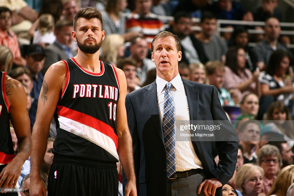 Joel Freeland of the Portland Trail Blazers and head coach Terry Stotts discuss the game against the Utah Jazz at EnergySolutions Arena on October 07...