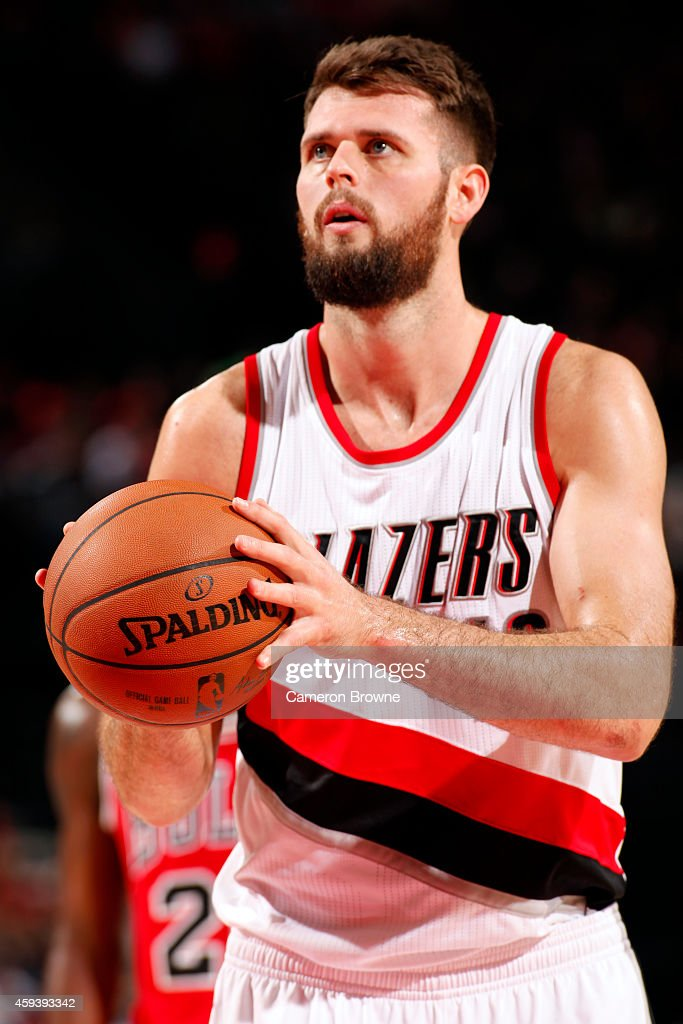 <a gi-track='captionPersonalityLinkClicked' href=/galleries/search?phrase=Joel+Freeland&family=editorial&specificpeople=757235 ng-click='$event.stopPropagation()'>Joel Freeland</a> #19 of the Portland Trail Blazers attempts a free throw against the Chicago Bulls on November 21, 2014 at the Moda Center Arena in Portland, Oregon.