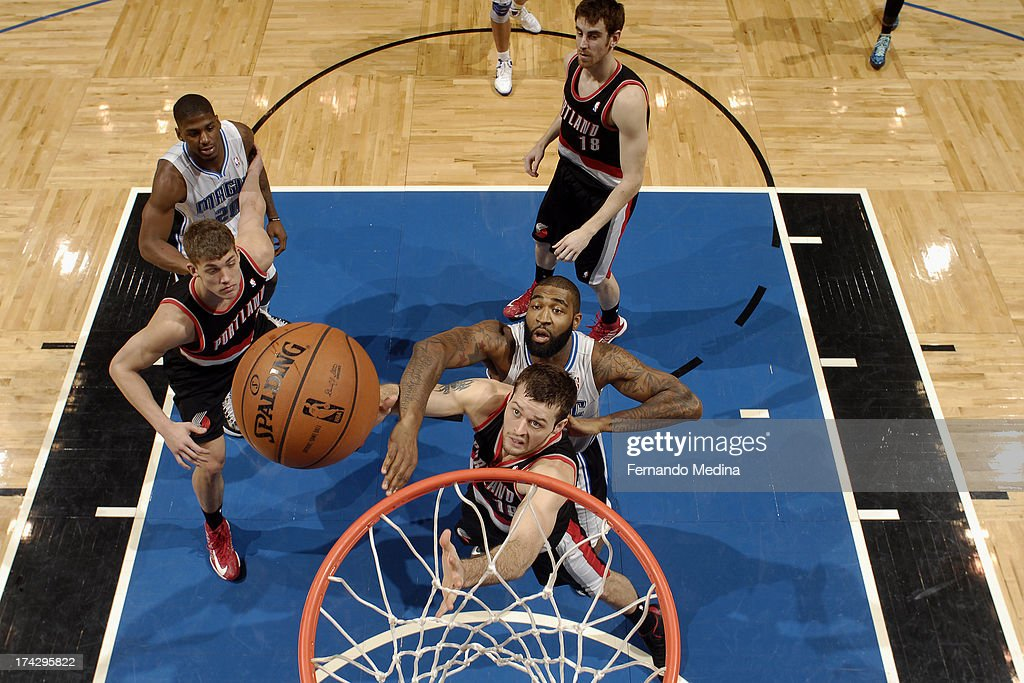 <a gi-track='captionPersonalityLinkClicked' href=/galleries/search?phrase=Joel+Freeland&family=editorial&specificpeople=757235 ng-click='$event.stopPropagation()'>Joel Freeland</a> #19 of the Portland Trail Blazers battles for a rebound with <a gi-track='captionPersonalityLinkClicked' href=/galleries/search?phrase=Kyle+O%27Quinn&family=editorial&specificpeople=9027719 ng-click='$event.stopPropagation()'>Kyle O'Quinn</a> #2 of the Orlando Magic during the game on February 10, 2013 at Amway Center in Orlando, Florida.