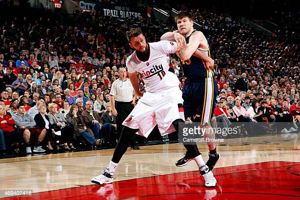 Joel Freeland of the Portland Trail Blazers battles for position against Jack Cooley of the Utah Jazz on April 11 2015 at the Moda Center Arena in...