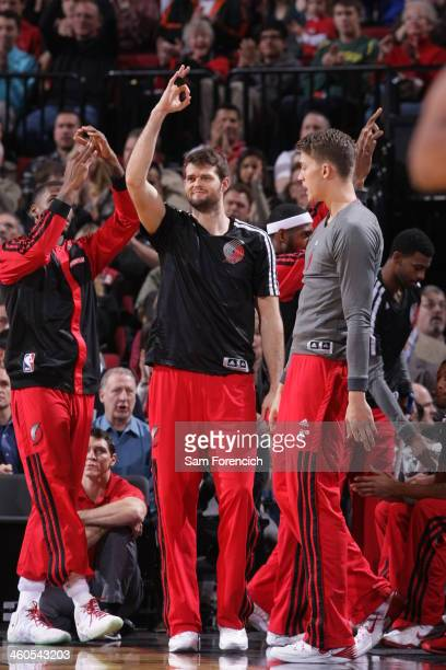 Joel Freeland of the Portland Trail Blazers celebrates from the bench against the Charlotte Bobcats on January 2 2014 at the Moda Center Arena in...